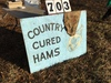 "Painted sign 36"" x 48"" (double-sided), 1 side ""Country Cured Hams"" & other ""Fishing Worms For Sale"""