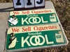 "Pair of metal signs, stamped Kool Cigarettes, 1 good condition, 1 moderate condition, 26"" x 11"""
