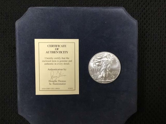 2011 Silver American Eagle Fine Silver Dollar; 1 Ounce; Uncirculated; includes Certificate of Authen