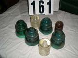 Six Glass Insulators (Two Clear, Four Blue) and One Brown Pottery Insulator