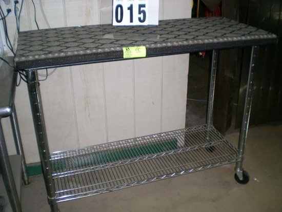 """Stainless table on casters; 50""""l x 24""""d x 39""""t"""