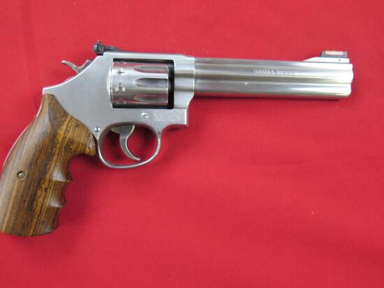Smith & Wesson 617-6 .22LR 10 shot double/single action revolver, wood grip