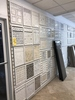 LOT CONSISTING OF TILE SAMPLES HANGING ON WALL