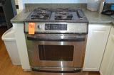 Lot - Kitchen Appliances Including: Oven with 4-Burner Stove, (2) Refridgerators, Kureg Coffee Maker