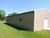 Approximatley a 2002 Steel Pole Building 32x48 in size.  Two overhead doors Image 6
