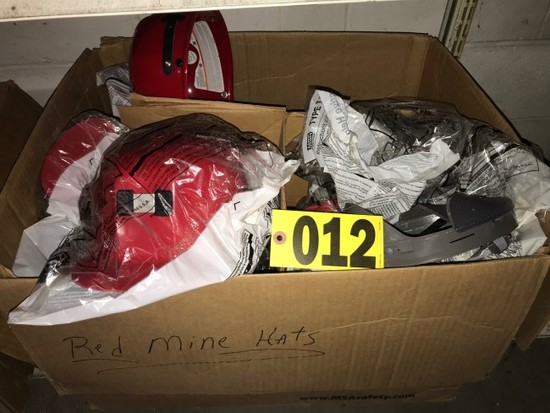 Box of red mine hats