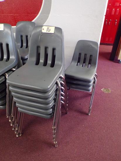 (12) Gray plastic school desk chairs