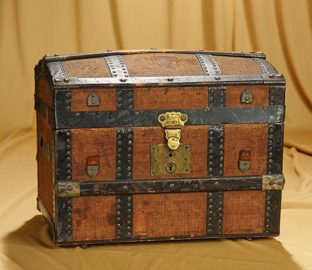 "14"" w. x 9"" x 11"" American domed doll trunk with fancily-fitted interior. $300/500"