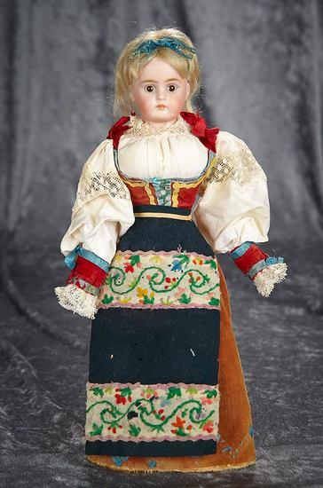 "13""  Beautiful Sonneberg bisque closed mouth, 270, Bahr and Proschild original costume. $400/500"