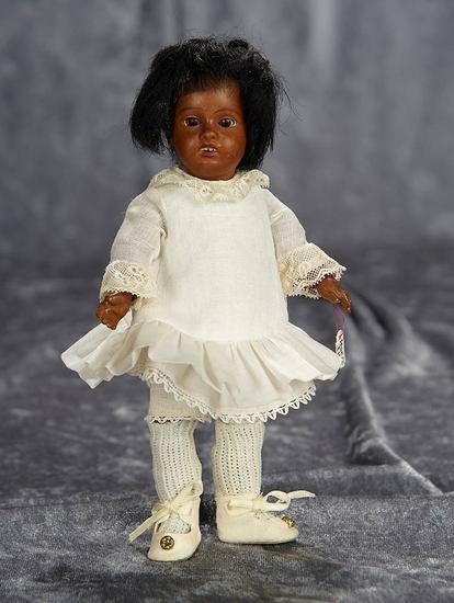 "7"" German brown-complexioned bisque miniature doll by Gebruder Kuhnlenz. $300/400"