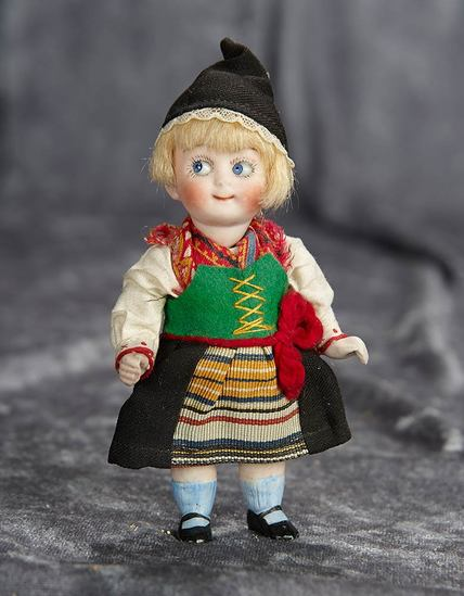 """5"""" German all-bisque googly, model 222, with original folklore costume. $400/500"""