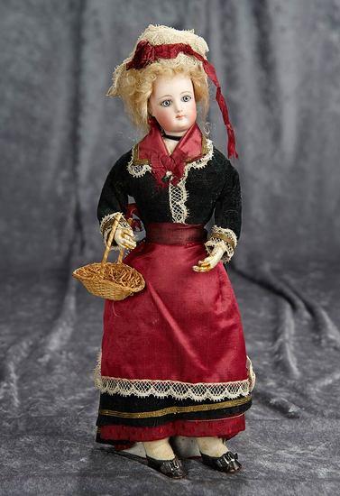 "12"" French bisque poupee by Gaultier in wonderful original silk costume. $1100/1400"