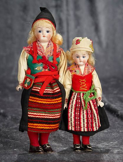 """7""""-9"""" Two German bisque sister dolls in original folklore costumes. $400/500"""