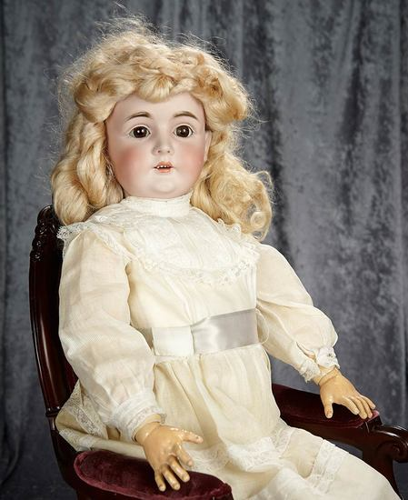 "33"" German bisque child, 164, by Kestner with original body and body finish. $500/700"