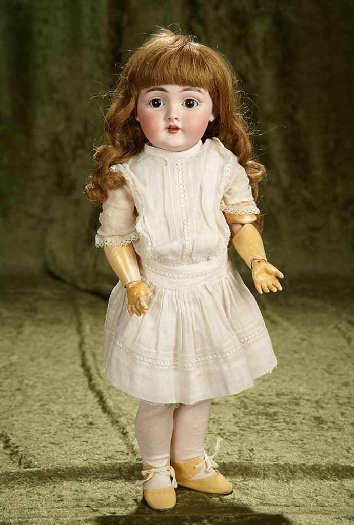 """17"""" German bisque character, 143, by Kestner, original body and body finish. $400/500"""