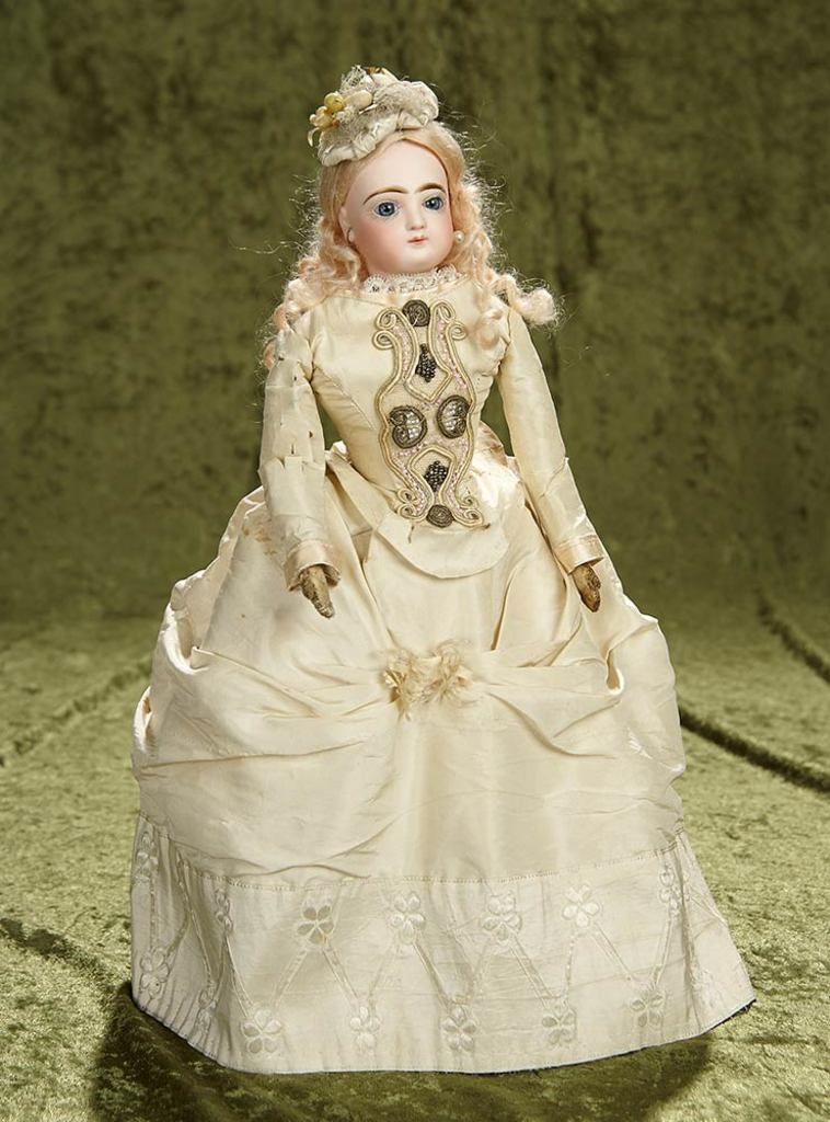 """15"""" French bisque poupee by Jumeau in lovely ivory silk costume. $1400/1700"""