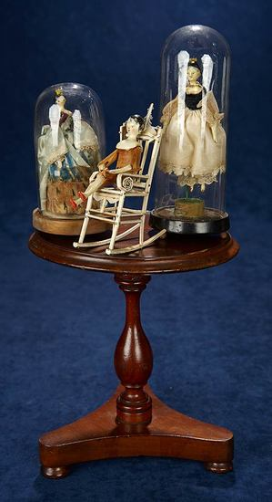 Early Walnut Doll Table with a Trio of Miniature Grodnertal Dolls 1100/1500