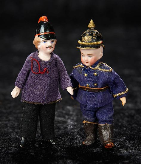 Two German All-Bisque Miniature Dolls in Uniforms 300/500