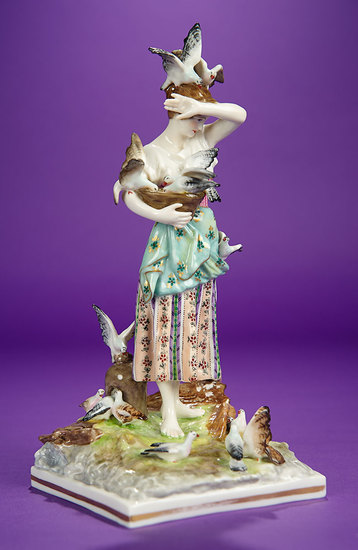German Porcelain Figurine Depicting a Barefoot Lady Feeding Birds 300/500