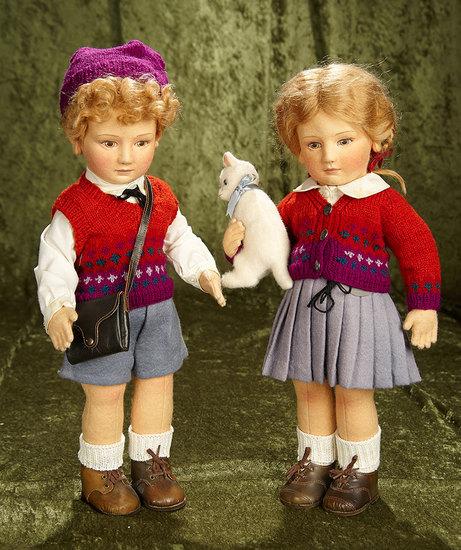 "17"" Pair, American felt character dolls, ""Lisa"" and ""Scott"" by R. John Wright. $900/1200"