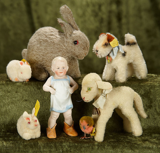 """1""""-6"""" German animals by Steiff and German all-bisque """"Boy in Papa's Shoes"""" by Heubach. $400/500"""