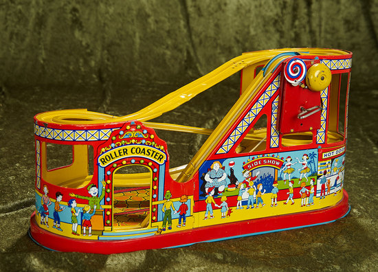 """18"""" American lithographed tin mechanical roller coaster by Chein. $200/250"""