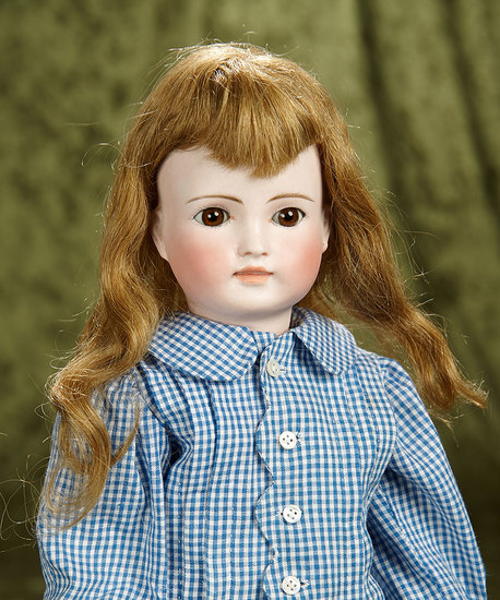 "17"" Sonneberg bisque doll with closed mouth, beautiful expression, original body. $700/1100"