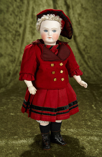 "15"" Sonneberg bisque doll with closed mouth, original early body. $700/900"