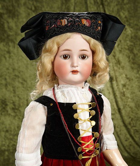 "30"" German bisque child by K*R with original body, body finish, mohair wig. $500/700"