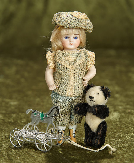 "5 1/2"" German all-bisque doll with yellow ankle boots, and accessories. $300/500"