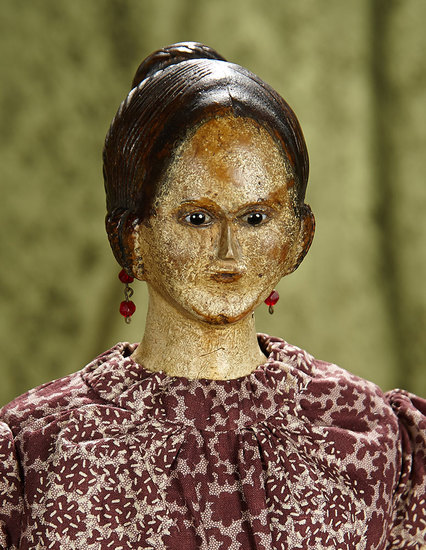 "20"" German carved wooden lady with unique sculpted hair and glass eyes. $400/600"