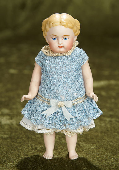 "6 1/2"" German all-bisque doll with sculpted blonde hair and bare feet. $300/500"