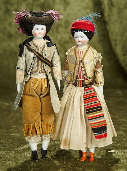 "Pair, 11"" German porcelain dolls with original traditional costumes. $600/800"