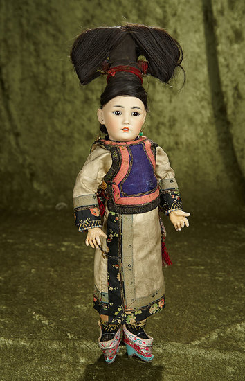"15"" German amber-tinted bisque portrait of Asian child in original costume and coiffe. $1200/1500"