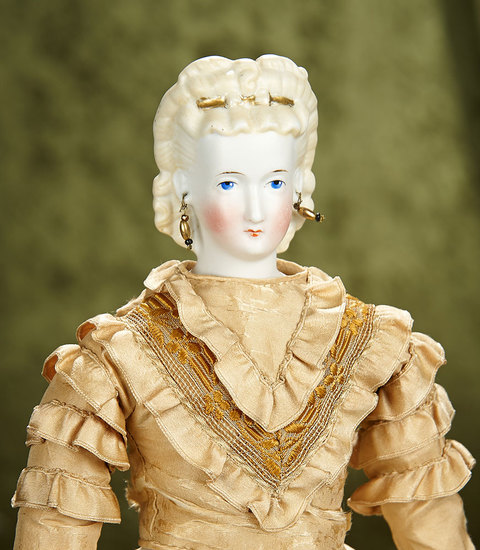 "17"" German bisque lady doll with blonde sculpted hair with gilt hair comb. $700/900"
