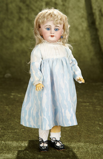 "14"" Pretty German bisque child, 1009, by Simon and Halbig with original body and wig. $500/700"