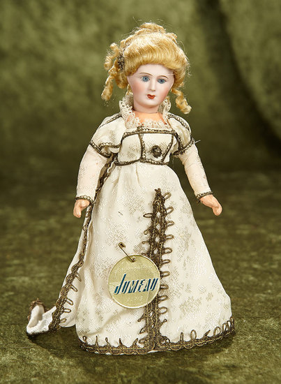 "9"" French bisque doll by Unis France with original costume and Jumeau label. $800/1000"