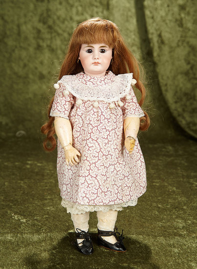 "16"" German bisque closed mouth doll, 949, by Simon and Halbig. $1100/1300"