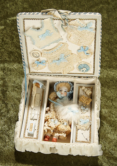 "5"" German all-bisque miniature in presentation case with costumes and accessories. $500/750"