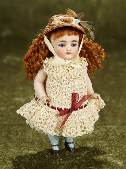 "7"" German all-bisque miniature doll with cobalt blue eyes and closed mouth. $500/750"