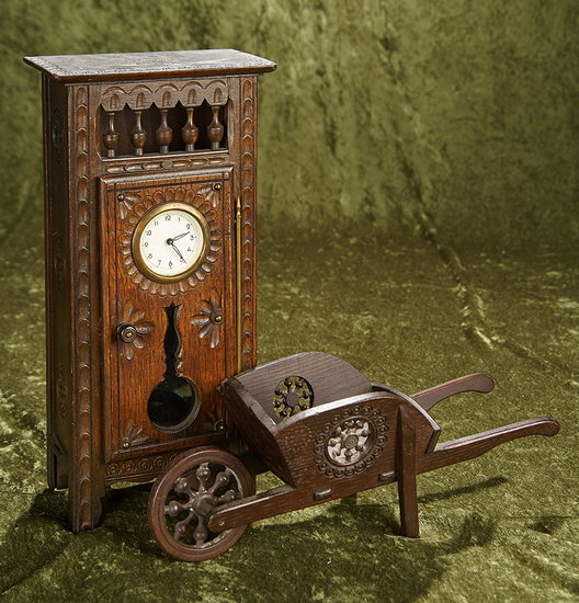 """14"""" French Brittany wooden cupboard with clock along with rare Brittany wheelbarrow. $300/500"""
