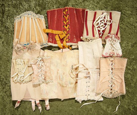 "Eight antique corsets for 15""-24"" poupees. $300/500"