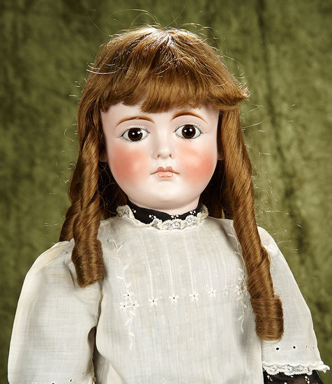 """27"""" Beautiful Sonneberg bisque brown-eyed child doll with closed mouth. $1200/1500"""