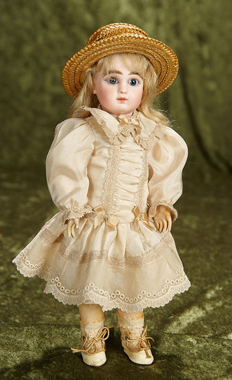 """11"""" Petite French bisque Bebe Steiner, Figure A, with original Au Nain Bleu label. $1800/2300"""