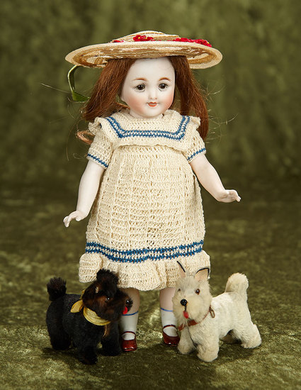 """9"""" German all-bisque doll in rare larger size with two miniature pups. $500/750"""