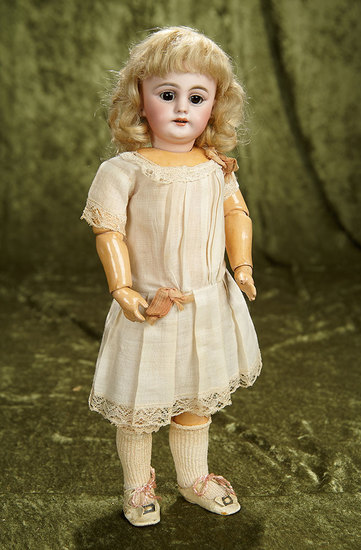 "14"" German bisque child doll, 1009, by Simon & Halbig with original wig and body. $400/600"