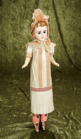 "18"" German bisque closed mouth child with unusual elongated body and original costume. $400/600"