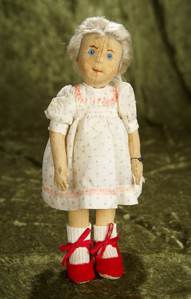 """11"""" German felt character doll by Steiff with button in ear. $800/1100"""