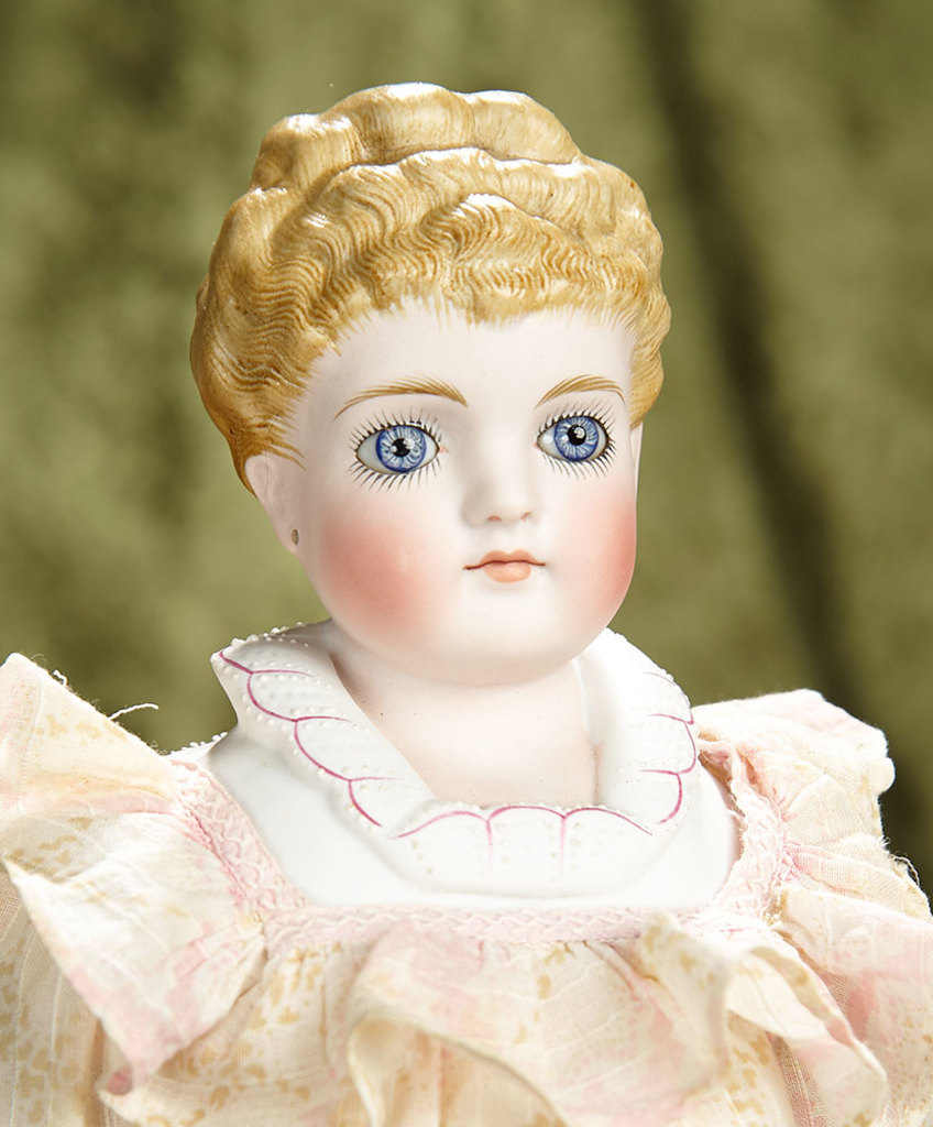 "19"" German bisque doll with rare sculpted hair and glass eyes, model 135, by Kling. $800/1100"