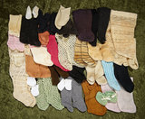 A large collection of doll socks, mostly antique, some handknit. $300/400